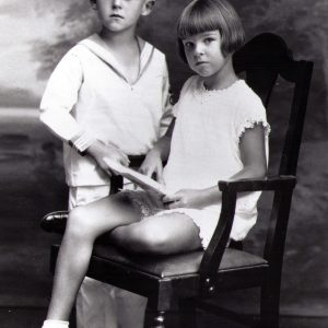 A posed portrait of a young Henry Segerstrom and his sister Ruth Ann.