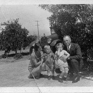 Henry Segerstrom and his sister Ruth Ann pose with their parents Nellie Ruth and Anton Segerstrom in the driveway of the family home.
